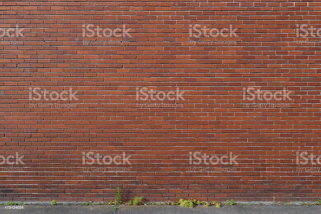 Old Brick Wall Background with Sidewalk stock photo
