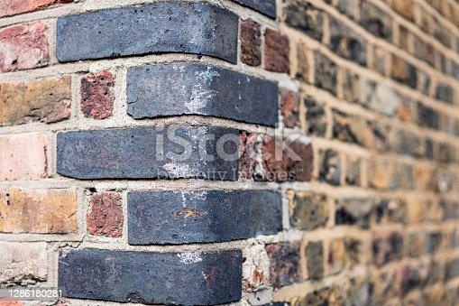 istock Old brick wall corner showing wear 1286180281