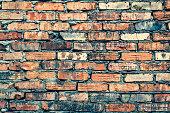 Old brick wall of red color. Horizontal photo of masonry.\