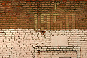 Old brick red and white wall with number 1958 year
