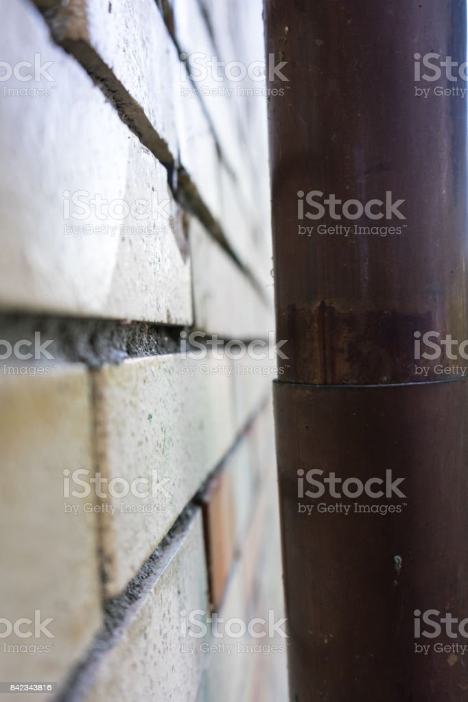 Old Brick Wall Side View With Nickel Copper Tube Royalty Free Stock Photo