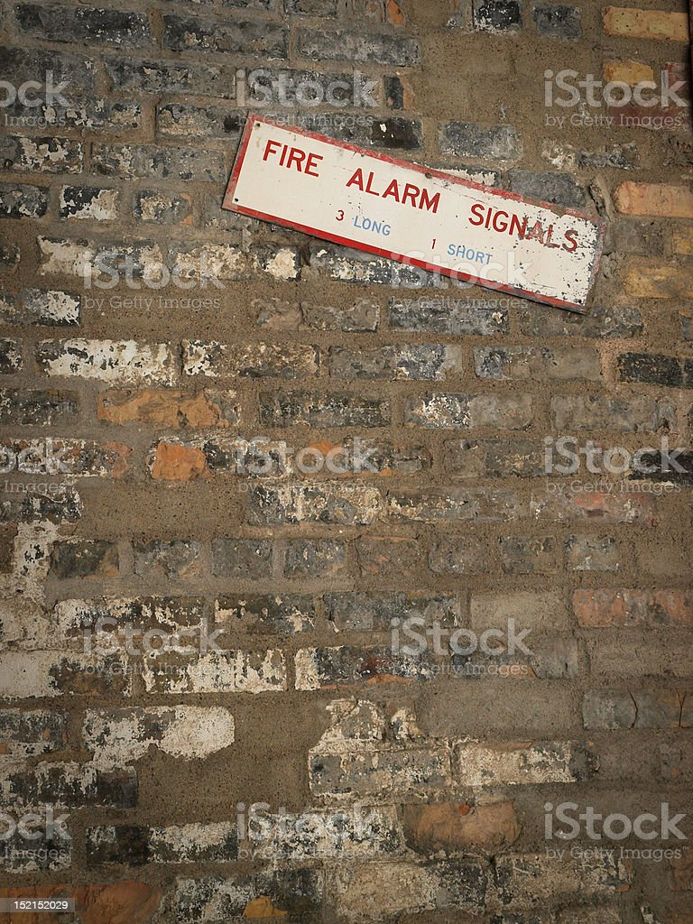 Old brick wall wilth fire sign stock photo