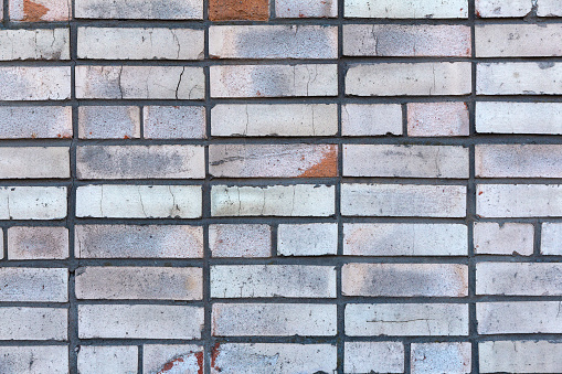 Old gray brick wall as industrial background