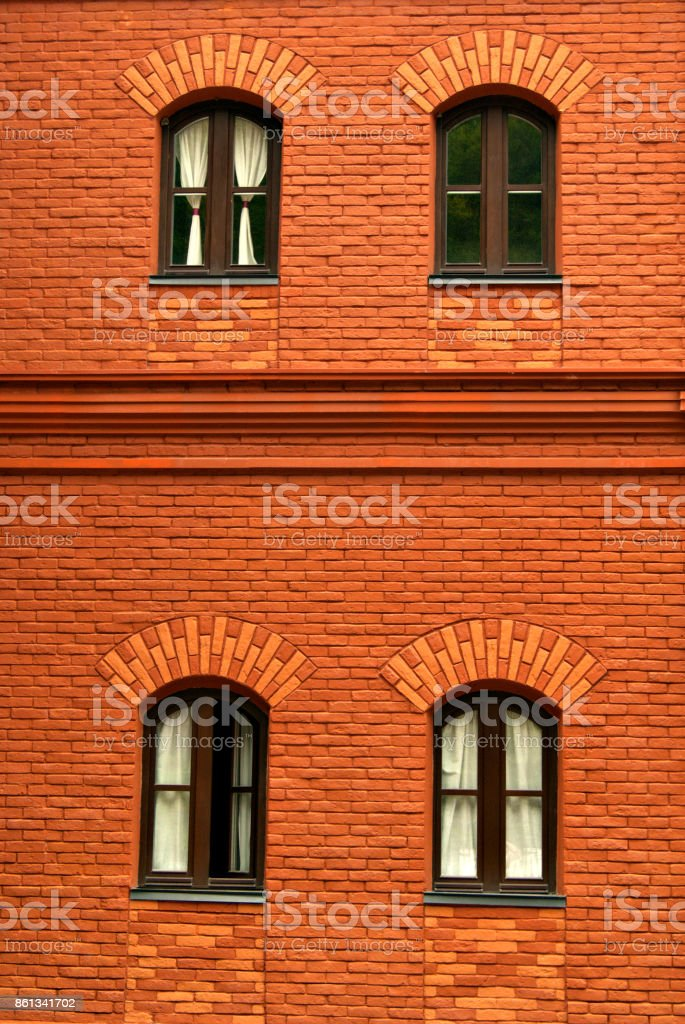 old brick wall with four window stock photo