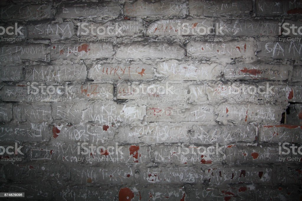 old brick wall with inscriptions of the names stock photo