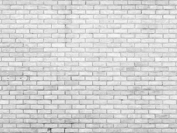 old brick wall with repeating pattern stock photo
