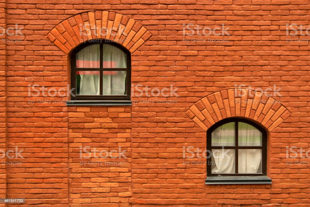 old brick wall with two window stock photo