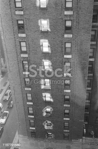 istock old bricks building with windows reflection 1157701580