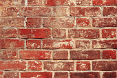 Old red brick masonry as a background close up