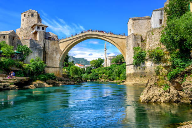 Old Bridge and Mosque in the Old Town of Mostar, Bosnia stock photo