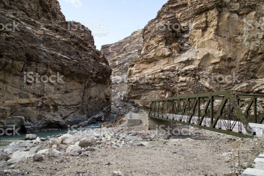 Old bridge and rocky Himalayan mountain stock photo