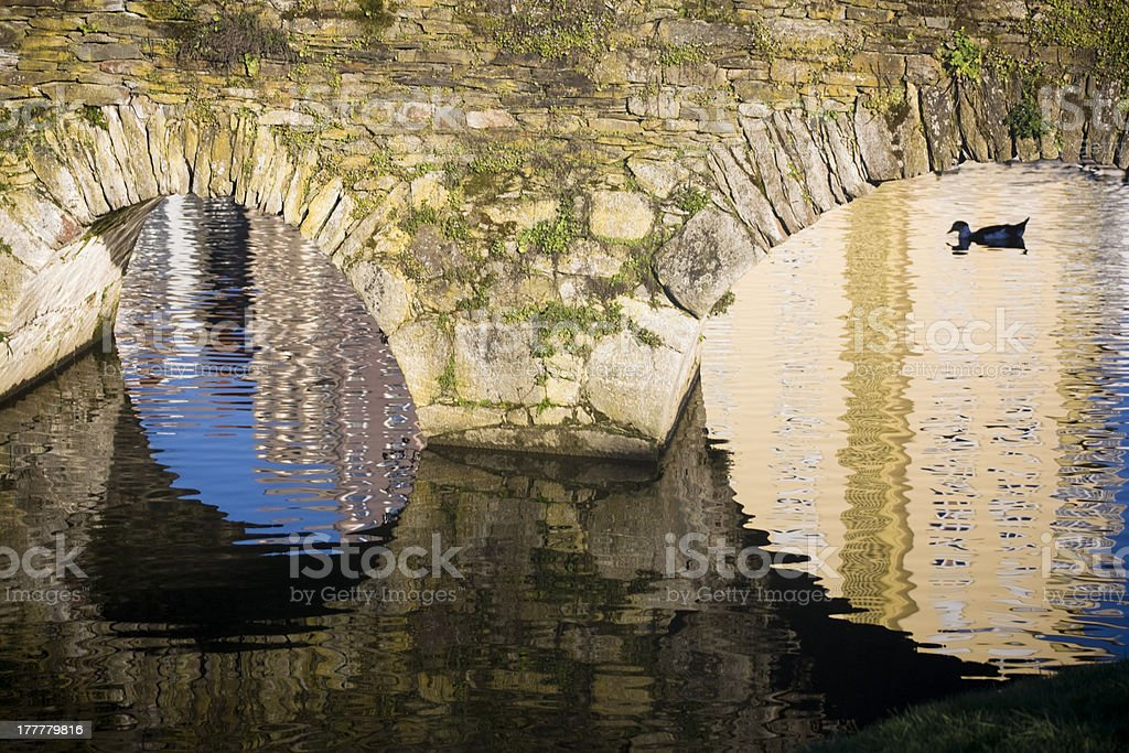 Old bridge and silhouetted duck royalty-free stock photo