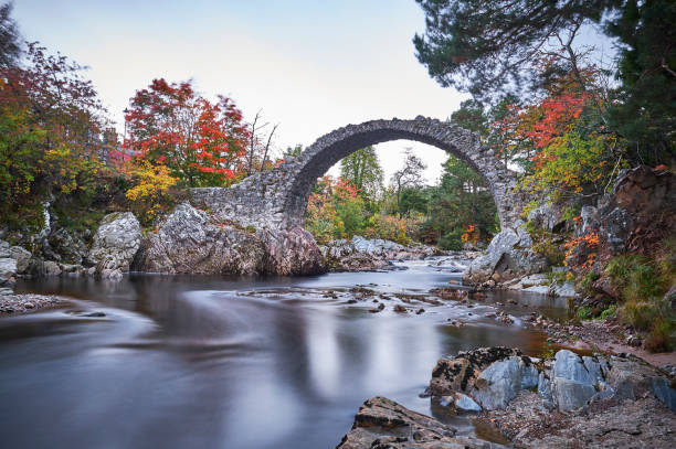 Old bridge in scotland where the river flows underneath the rocks in the fall. Old bridge in scotland where the river flows underneath the rocks in the fall. north coast 500 stock pictures, royalty-free photos & images