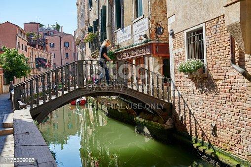 Venice, Italy - June 01, 2019: a woman crossing