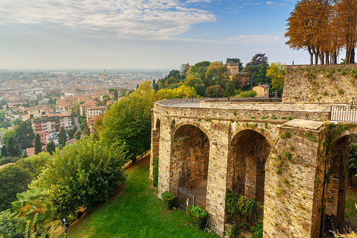 Old bridge on Via Sant Alessandro street to upper city Cita Alta. Bergamo. Italy