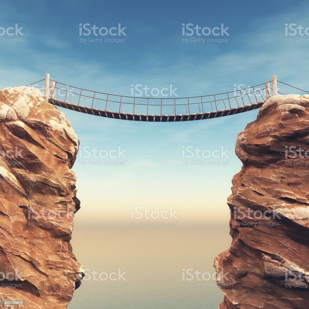 Old bridge over between two big rocks stock photo