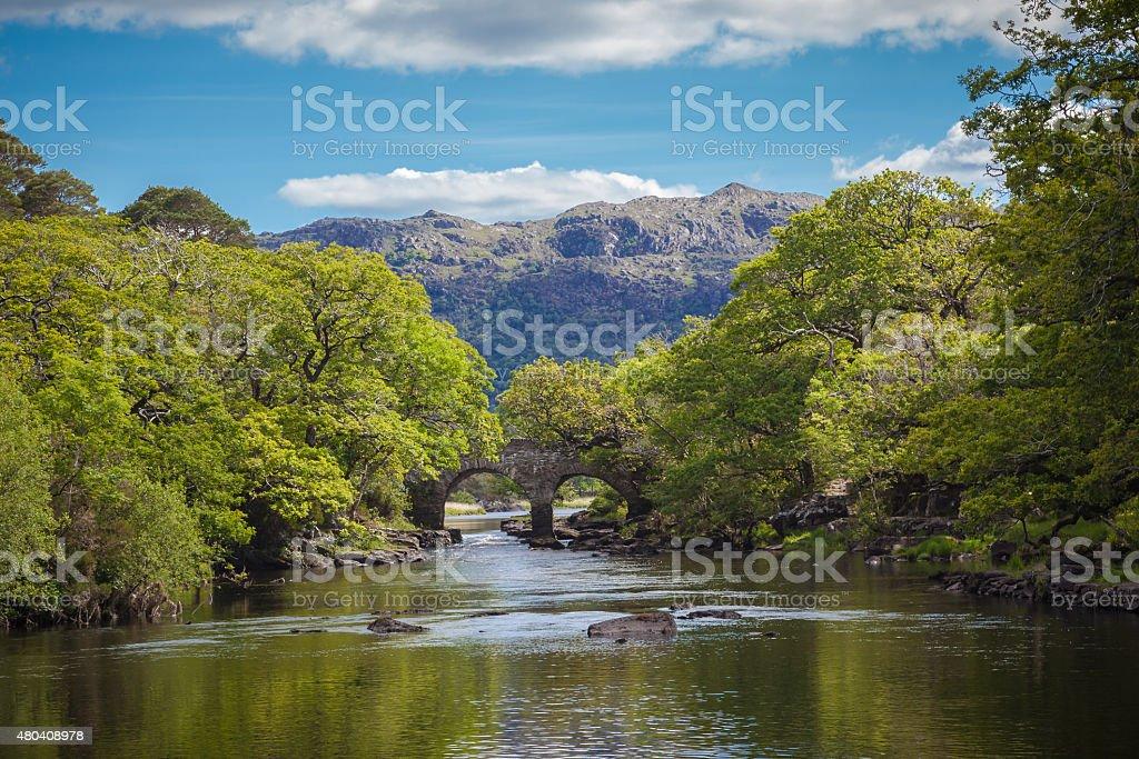Old Bridge Over Calm Waters stock photo