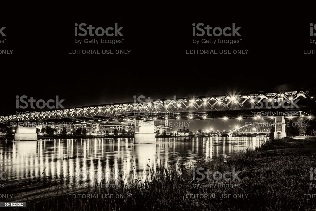 Old bridge over river Danube in Bratislava at night with reflection in water, Slovakia, Europe. royalty-free stock photo