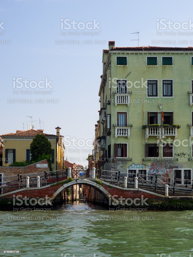 Old bridge with metal ramp over a canal, Venice stock photo