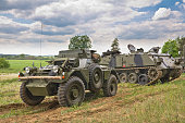 "British light fast 4WD reconnaissance vehicle - The Daimler ""Dingo"" Scout Car and  AFV 434 tracked armoured transport vehicle on the battlefield"