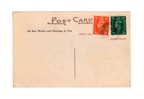 An old British postcard, postmarked July 1952, from the reign of Queen Elizabeth II but bearing stamps from her father's reign. King George VI died on 6th February of that year.