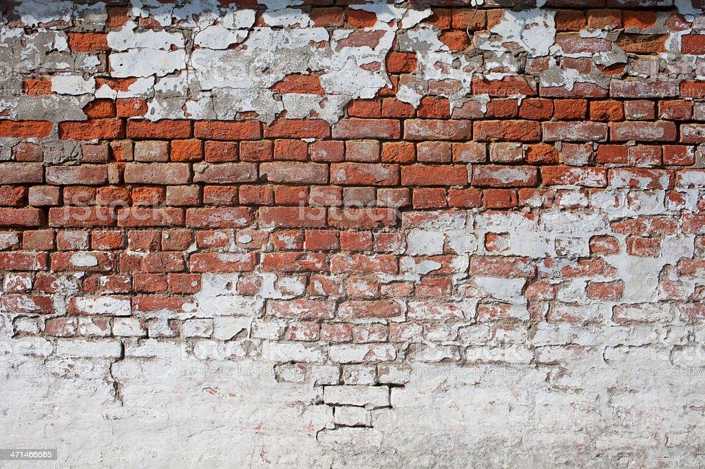 Old, broken and fragmented brick wall. royalty-free stock photo
