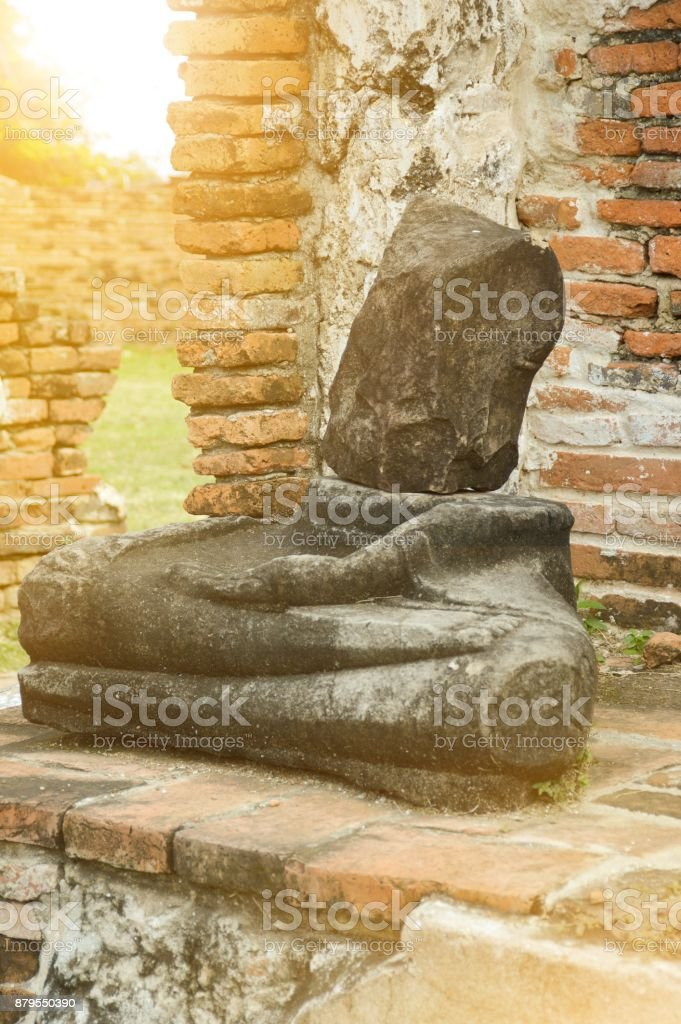 old broken Buddha statue at Chaiwatthanaram Temple, Ayutthaya, Thailand stock photo