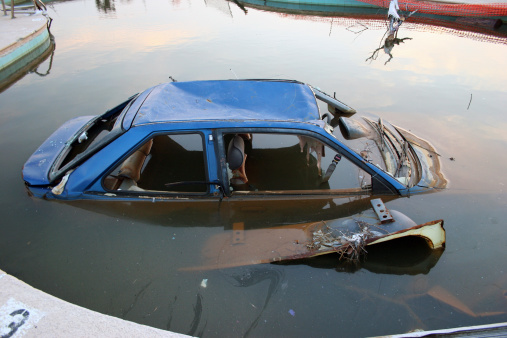 Car submerged in pool because of Hurricane Katrina. Also check out:
