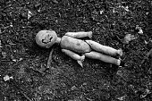 istock Old broken doll on the pile of the ash 828766598