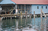 Old broken down fishermans boathouse at the marina in Gig Harbor, Washington, Pacific Northwest