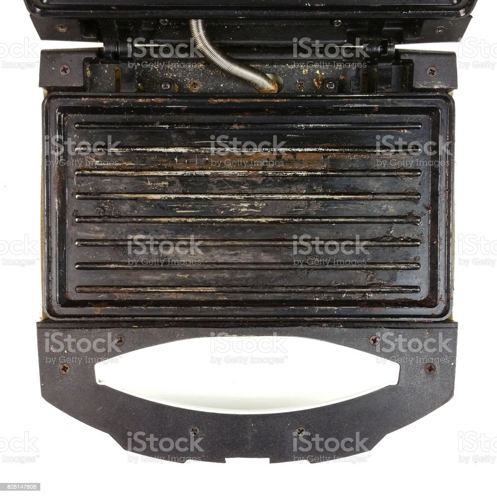 old broken eletric sandwich toaster - top view stock photo