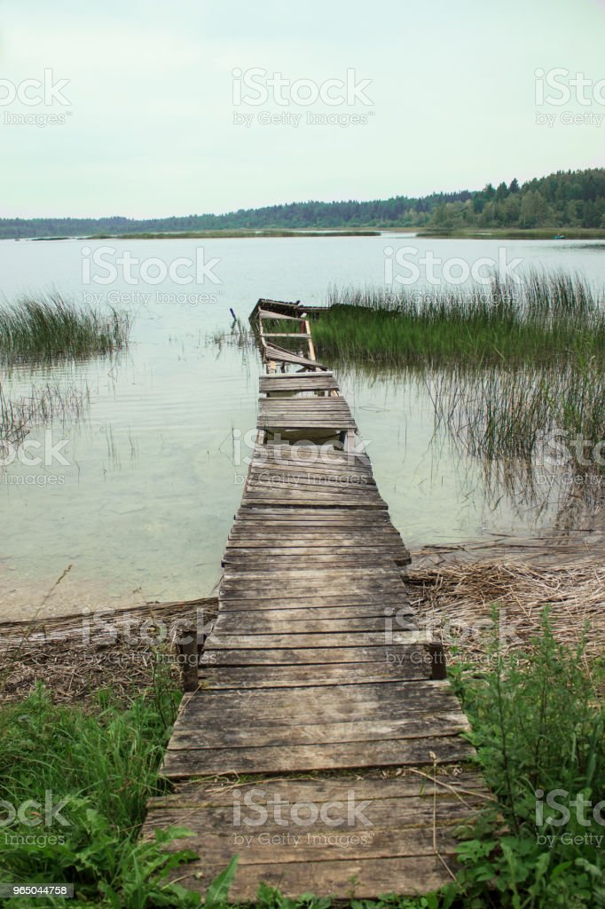 Old broken footbridges at lake zbiór zdjęć royalty-free