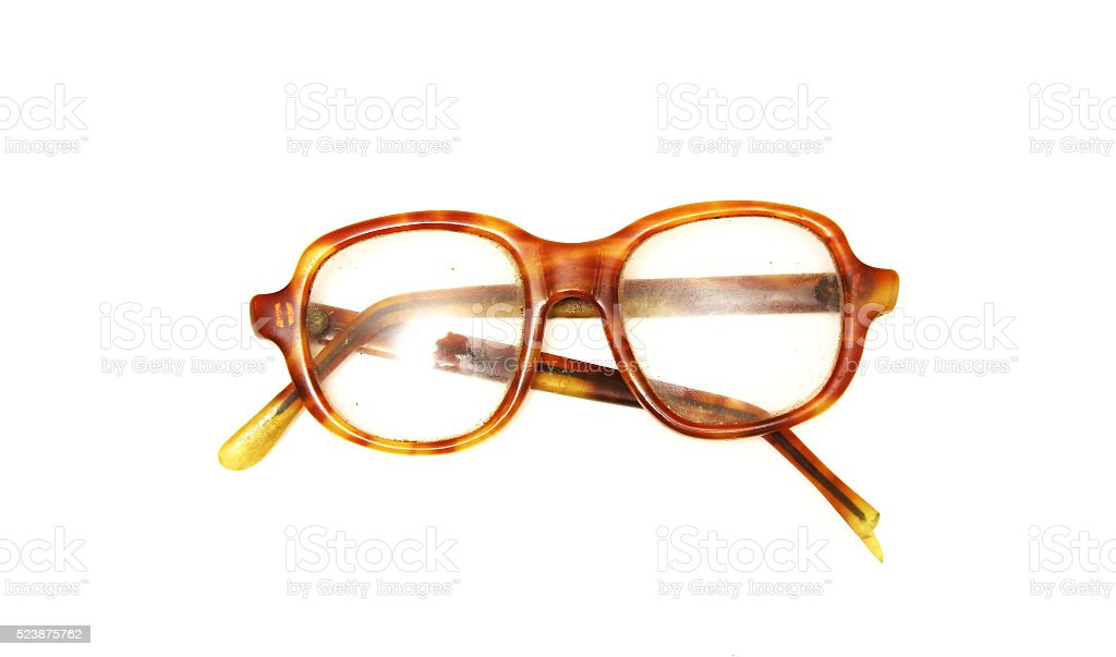 Old broken glasses on white background stock photo