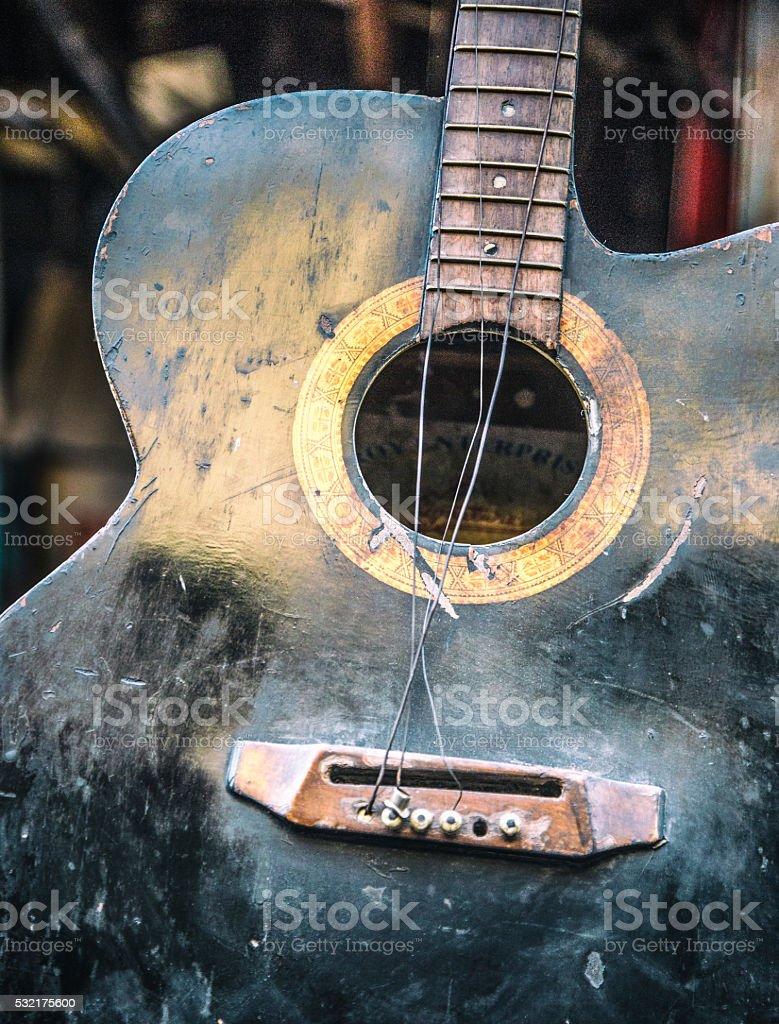 Old broken guitar stock photo