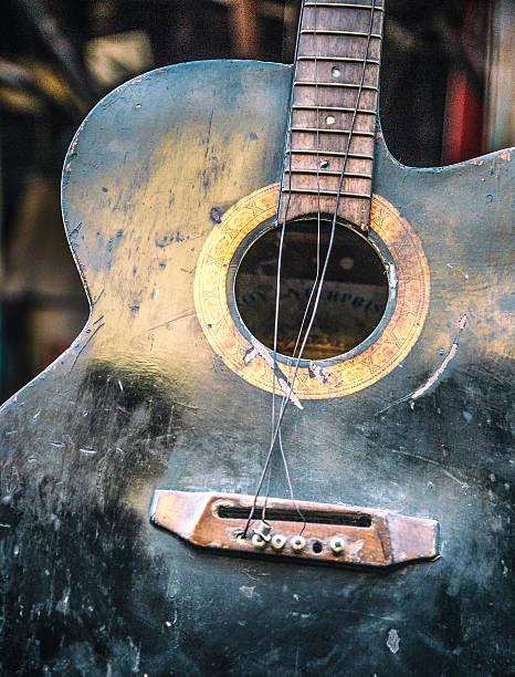 old broken guitar - broken guitar stock photos and pictures