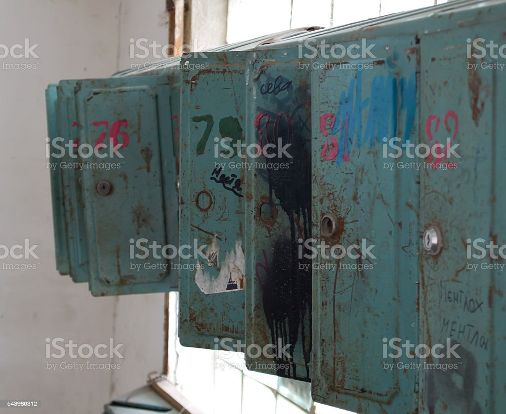 Old broken mailboxes stock photo