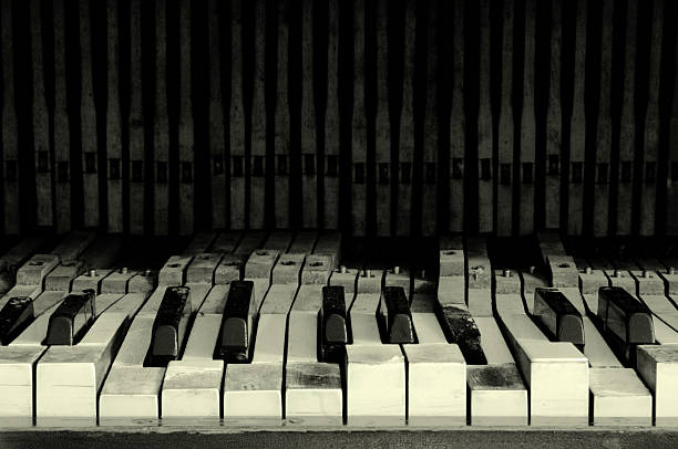 old broken piano black and white with film grain - broken guitar stock photos and pictures