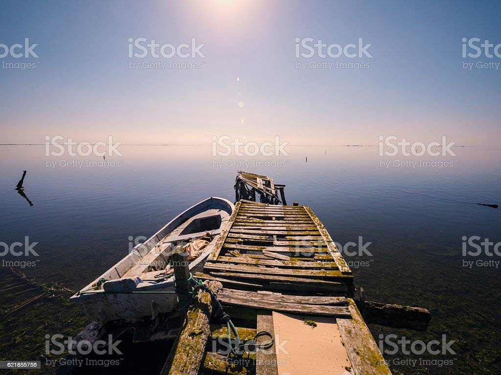 Old broken pier in the Ebro Delta Catalonia Spain stock photo
