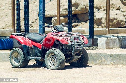Old broken quad bike in the desert