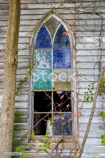 Old Broken Stained Glass Window On Abandoned Church
