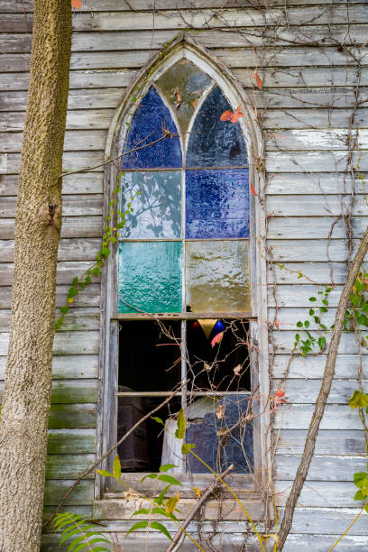 Old Broken Stained Glass Window On Abandoned Church stock photo