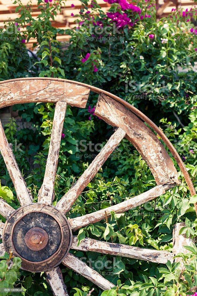 Old broken wagon wheel stock photo