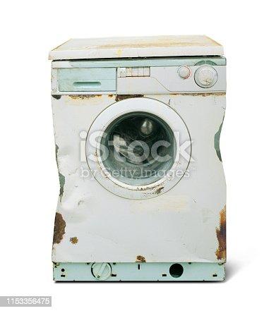 Battered washing machine on white background.