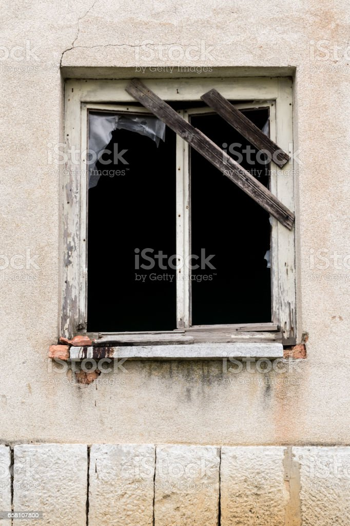 old broken window of an abandoned house royalty-free stock photo