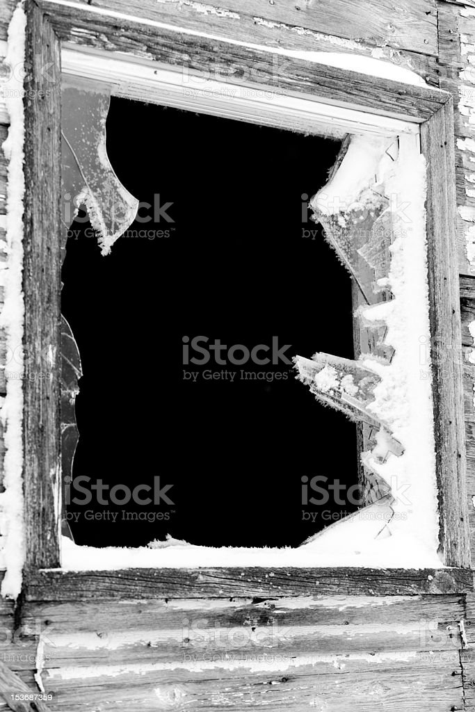 Old broken window on a deserted house royalty-free stock photo