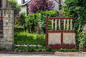 istock Old broken wooden gates in the Park 1269733859