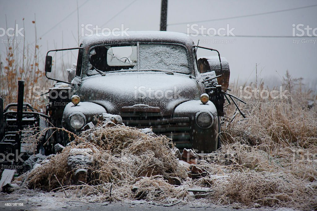 Old Broken-Down Truck in a Snow Storm stock photo