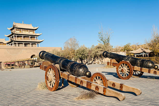 Old  bronze artilleries inside Jiayuguan castle stock photo