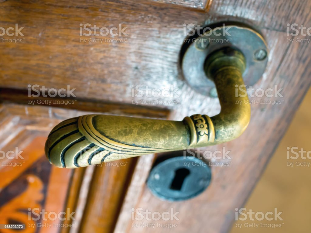 Old bronze door handle in the form of animal paws stock photo