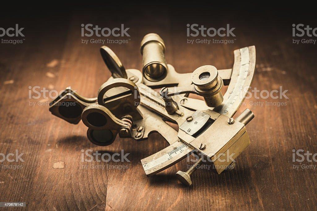 old bronze sextant stock photo